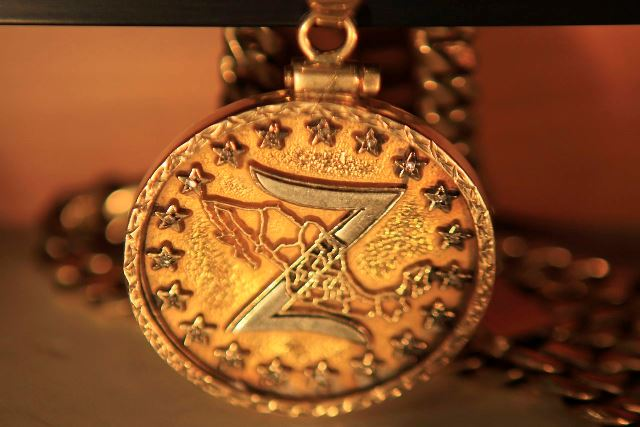 A medal of the Zetas drug cartel is displayed in the Drugs Museum at the headquarters of the Ministry of Defense in Mexico City, in this August 18, 2010 file picture. To match Special Report MEXICO-DRUGS/ZETAS   REUTERS/Eliana Aponte/Files (MEXICO - Tags: CRIME LAW DRUGS SOCIETY MILITARY POLITICS)
