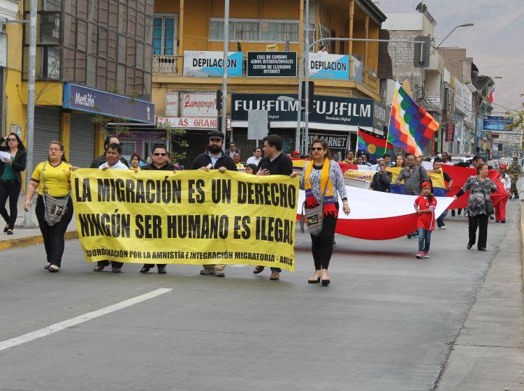 Más de cien inmigrantes marcharon en Iquique por la amnistía migratoria